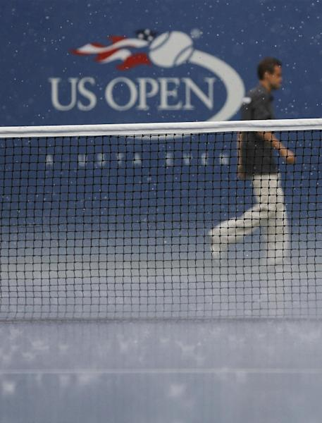 A heavy rain falls on Arthur Ashe Stadium suspending play during the fourth round of the 2013 U.S. Open tennis tournament, Monday, Sept. 2, 2013, in New York. (AP Photo/Mike Groll)
