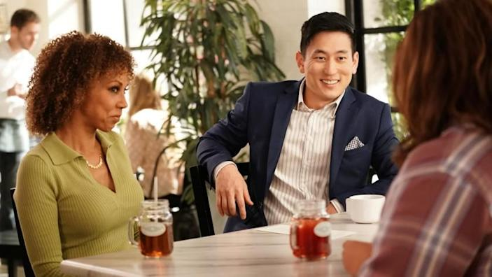 """American Housewife -- ABC TV Series, AMERICAN HOUSEWIFE - """"Encourage, Discourage"""" – Katie and Tami (Holly Robinson Peete) make fast friends with J.D. (Jake Choi), a luxury hotel manager whose promise of access to complimentary hotel rooms around the world sounds incredibly enticing. However, Katie's travel fantasy comes to a screeching halt when she learns J.D. is an aspiring first-time father who's counting on her for parenting guidance on an all-new episode of """"American Housewife,"""" WEDNESDAY, FEB. 3 (8:30-9:00 p.m. EST), on ABC. (ABC/Elizabeth Morris) HOLLY ROBINSON PEETE, JAKE CHOI Holly Robinson Peete, left, and Jake Choi guest star in """"American Housewife"""" on ABC."""