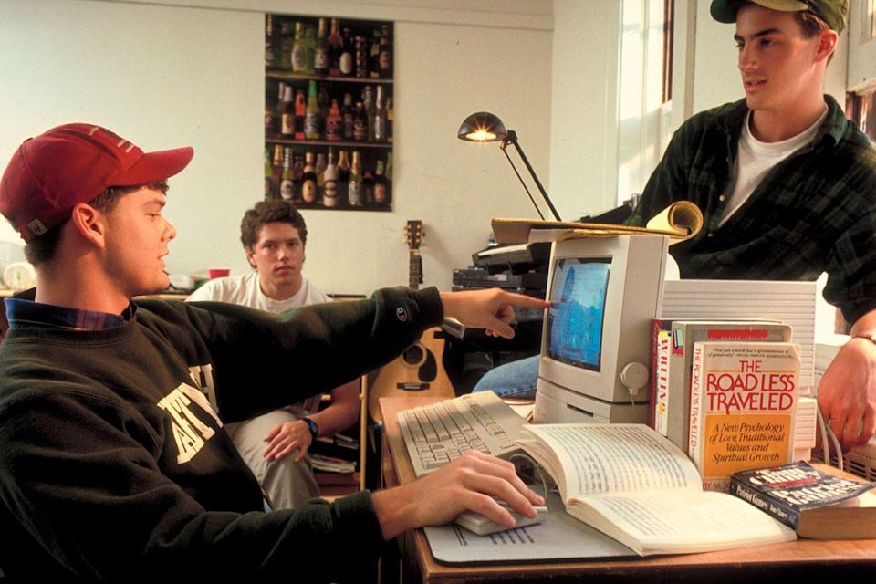"<p>A college freshman uses his school PC while hanging out <a href=""https://www.goodhousekeeping.com/home/decorating-ideas/g4587/dorm-room-ideas/"" rel=""nofollow noopener"" target=""_blank"" data-ylk=""slk:in his dorm room"" class=""link rapid-noclick-resp"">in his dorm room</a>. </p>"