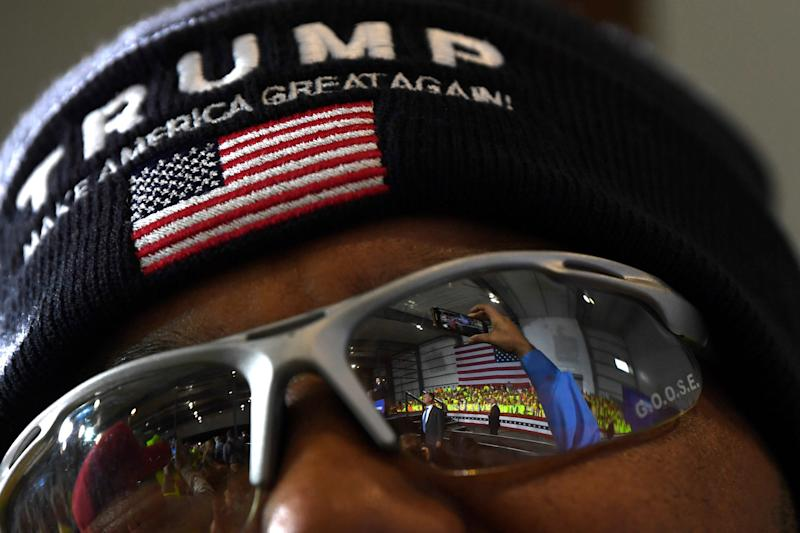 A man listens as President Donald Trump speaks at Shell's Pennsylvania Petrochemicals Complex on Aug. 13, 2019, in Monaca, Pa.