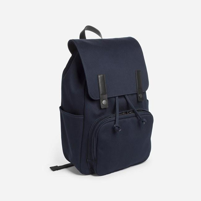 """I had an Everlane backpack all through college and I still use it when I travel. Needless to say, this backpack is a great investment. $68, Everlane. <a href=""""https://www.everlane.com/products/womens-modern-snap-backpack-navy?collection=womens-backpacks-bags"""">Get it now!</a>"""