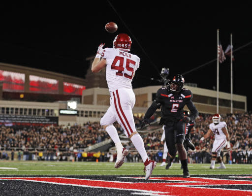 FILE - In this Saturday, Nov. 3, 2018, file photo, Oklahoma's Carson Meier (45) catches the ball for a touchdown during the first half of an NCAA college football game against Texas Tech in Lubbock, Texas. Oklahoma quarterback Kyler Murray has star receivers in Marquise Brown and CeeDee Lamb, yet he doesnt hesitate to throw to other options such as Meier. (AP Photo/Brad Tollefson, File)