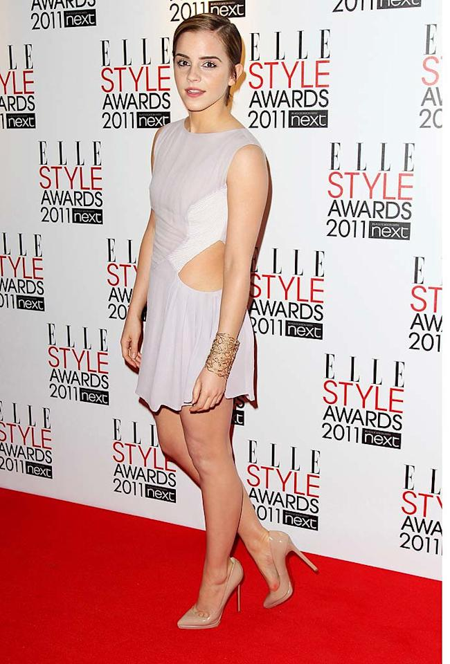 """Emma Watson rocked a chic 'do and a Hakaan cut-out mini, which allowed her to show off her fabulous gams. The 20-year-old """"Harry Potter"""" star received the Style Icon award from none other than Vivienne Westwood. Dave Hogan/Mission Pictures/<a href=""""http://www.gettyimages.com/"""" target=""""new"""">GettyImages.com</a> - February 14, 2011"""