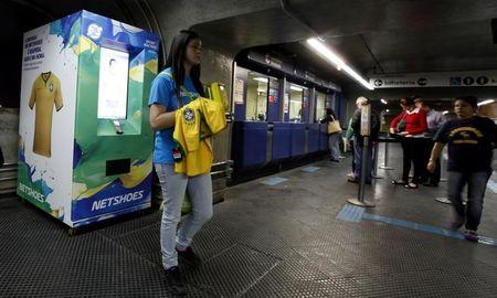 An automatic machines which sells the Brazilian national soccer shirt is seen in a subway station in Sao Paulo