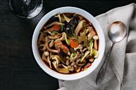 """A surprisingly easy dried porcini broth plus a mix of fresh wild mushrooms gives this soup its rich flavor and stunning look. <a href=""""https://www.epicurious.com/recipes/food/views/wild-mushroom-noodle-soup?mbid=synd_yahoo_rss"""" rel=""""nofollow noopener"""" target=""""_blank"""" data-ylk=""""slk:See recipe."""" class=""""link rapid-noclick-resp"""">See recipe.</a>"""