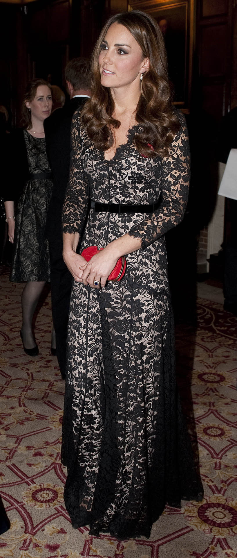 <p>The Duchess went back to St Andrews University for a dinner wearing a gorgeous nude-and-black lace gown by Temperley London. She carried a red Alexander McQueen box clutch and finished with suede Jimmy Choos.</p><p><i>[Photo: PA]</i></p>