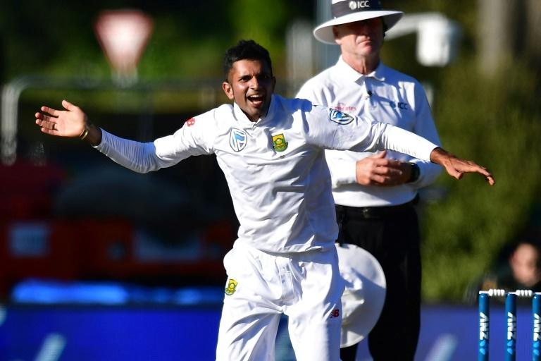 South Africa's Keshav Maharaj celebrates New Zealand's Henry Nicholls being caught on day two of their 1st Test match, at the University Oval in Dunedin, on March 9, 2017