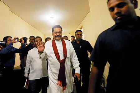 FILE PHOTO: Sri Lanka's newly appointed Prime Minister Mahinda Rajapaksa waves as he arrives at the parliament in Colombo, Sri Lanka November 29, 2018. REUTERS/Dinuka Liyanawatte
