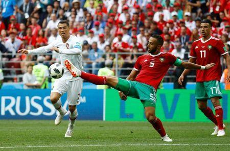 Soccer Football - World Cup - Group B - Portugal vs Morocco - Luzhniki Stadium, Moscow, Russia - June 20, 2018 Portugal's Cristiano Ronaldo in action with Morocco's Medhi Benatia REUTERS/Kai Pfaffenbach