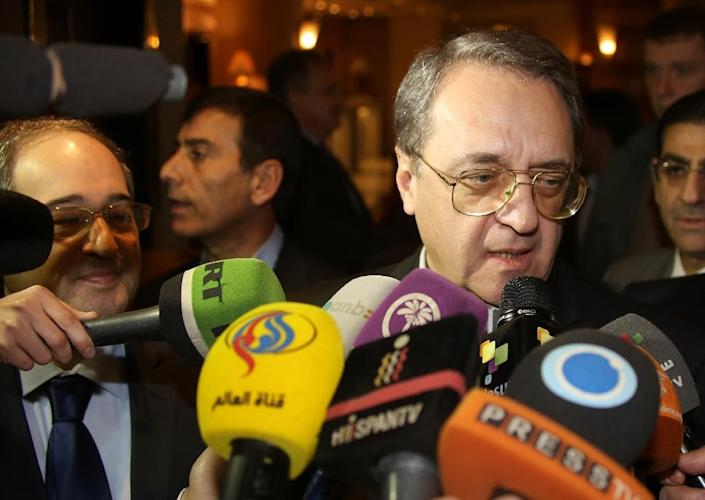 Russian Deputy Foreign Minister Mikhail Bogdanov (R) has announced a new round of Syria peace talks that include the US and Iran (AFP Photo/)