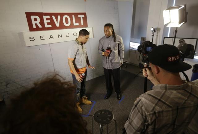 This May 6, 2014 photo shows NFL Draft prospect Calvin Pryor, a safety from Louisville, right, listening to a question during an interview with Revolt TV host Lawrence Jackson at the 5th Annual NFL Pre-Draft Gifting & Style Suite at the Sean John show room in New York. (AP Photo/Frank Franklin II)