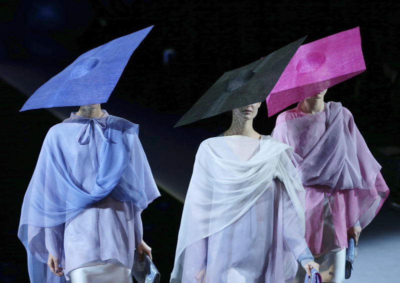 Models wear creations for Giorgio Armani's women's Spring-Summer 2014 collection, part of the Milan Fashion Week, unveiled in Milan, Italy, Monday, Sept. 23, 2013. (AP Photo/Antonio Calanni)