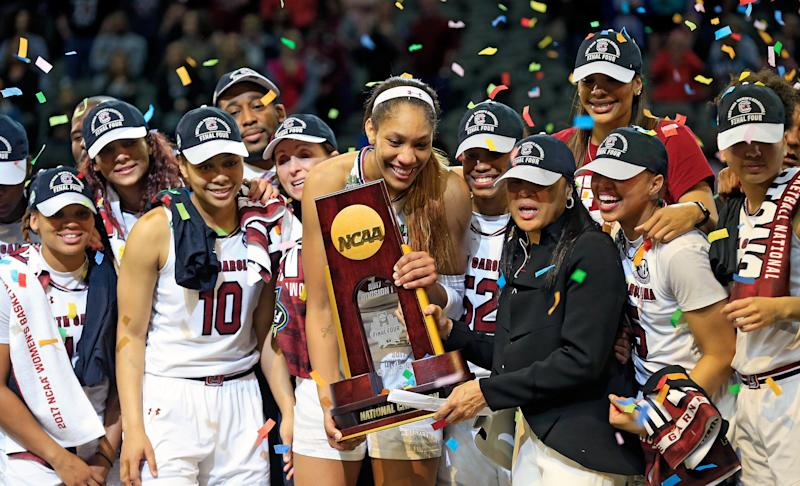 The University of South Carolinawomen's basketball teamholds up the NCAA trophy afterbeatingMississippi State on April 2.