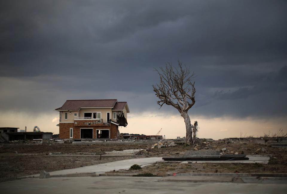 NAMIE, JAPAN - FEBRUARY 26:  A lone house sits on the scarred landscape, inside the exclusion zone, close to the devastated Fukushima Daiichi Nuclear Power Plant on February 26, 2016 in Namie, Fukushima Japan. The area is now closed to residents due radiation contamination from the Fukishima nuclear disaster. March 11, 2016 marks the fifth anniversary of the magnitude 9.0 earthquake and tsunami which claimed the lives of 15,894, and the subsequent damage to the reactors at TEPCO's Fukushima Daiichi Nuclear Power Plant causing the nuclear disaster which still forces 99,750 people to live as evacuees away from contaminated areas.  (Photo by Christopher Furlong/Getty Images)