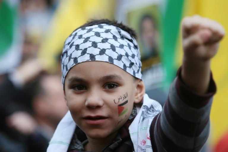 A boy with a Palestinian flag painted on his face during a rally organised by Lebanon's Hezbollah in Beirut on December 11, 2017
