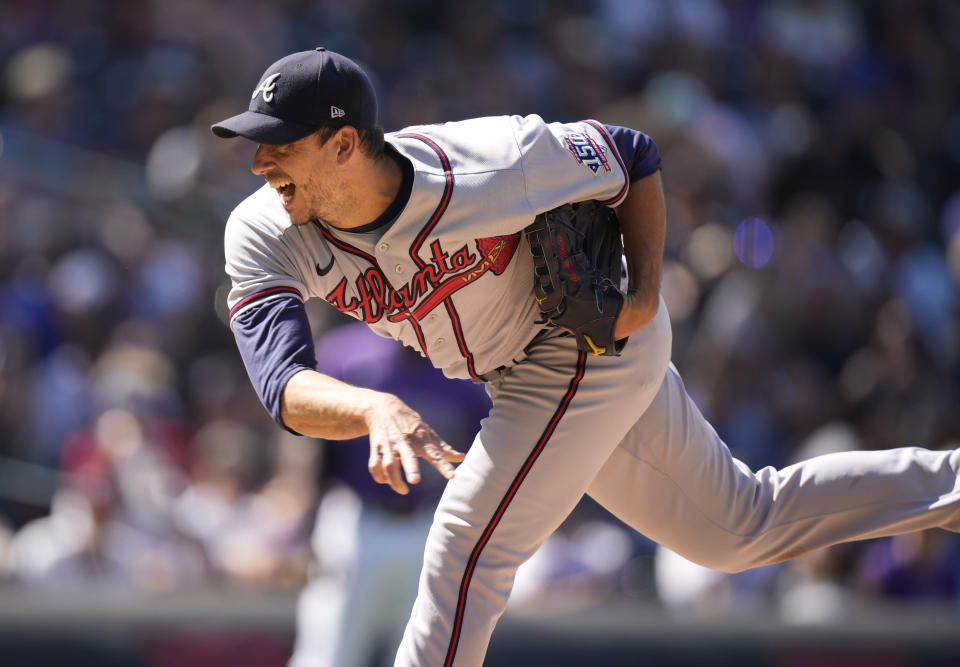 Atlanta Braves starting pitcher Charlie Morton works against the Colorado Rockies in the sixth inning of a baseball game Sunday, Sept. 5, 2021, in Denver. (AP Photo/David Zalubowski)
