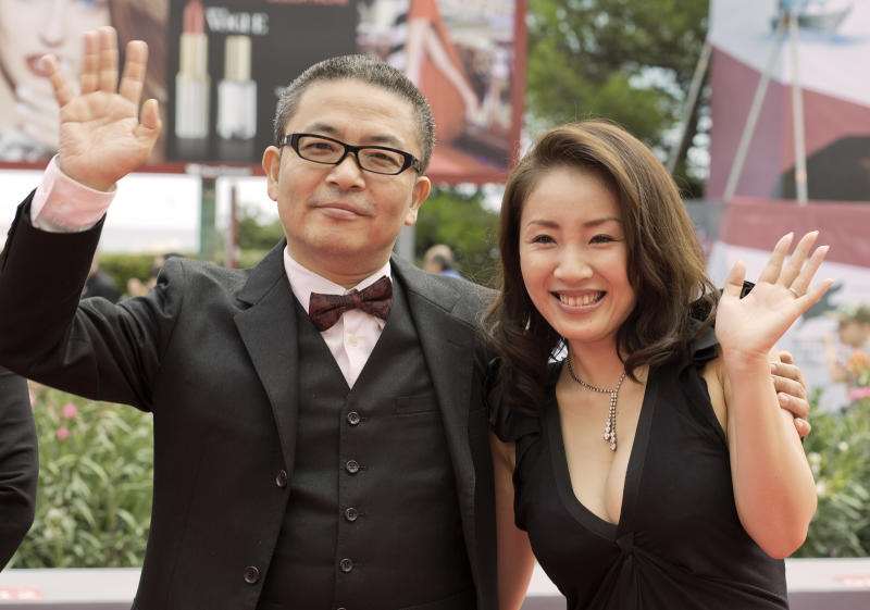 Director Sion Sono, left, and actress Megumi Kagurazaka arrive for the screening of the movie 'Why Don't You Play In Hell' at the 70th edition of the Venice Film Festival held from Aug. 28 through Sept. 7, in Venice, Italy, Thursday, Aug. 29, 2013. (AP Photo/Domenico Stinellis)