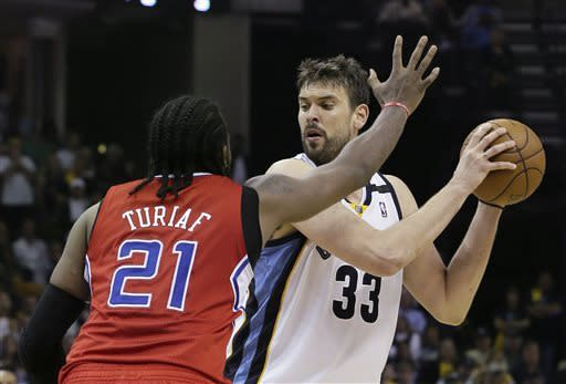 Memphis Grizzlies' Marc Gasol (33), of Spain, is pressured by Los Angeles Clippers' Ronny Turiaf (21), of France, during the second half of Game 4 in a first-round NBA basketball playoff series in Memphis, Tenn., Saturday, April 27, 2013. The Grizzlies defeated the Clippers 104-83. (AP Photo/Danny Johnston)
