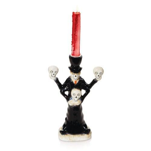 <p>Want to dress up your tablescape? Add <span>Boney's All Smiles Taper Candle Holder</span> ($25) to your display!</p>