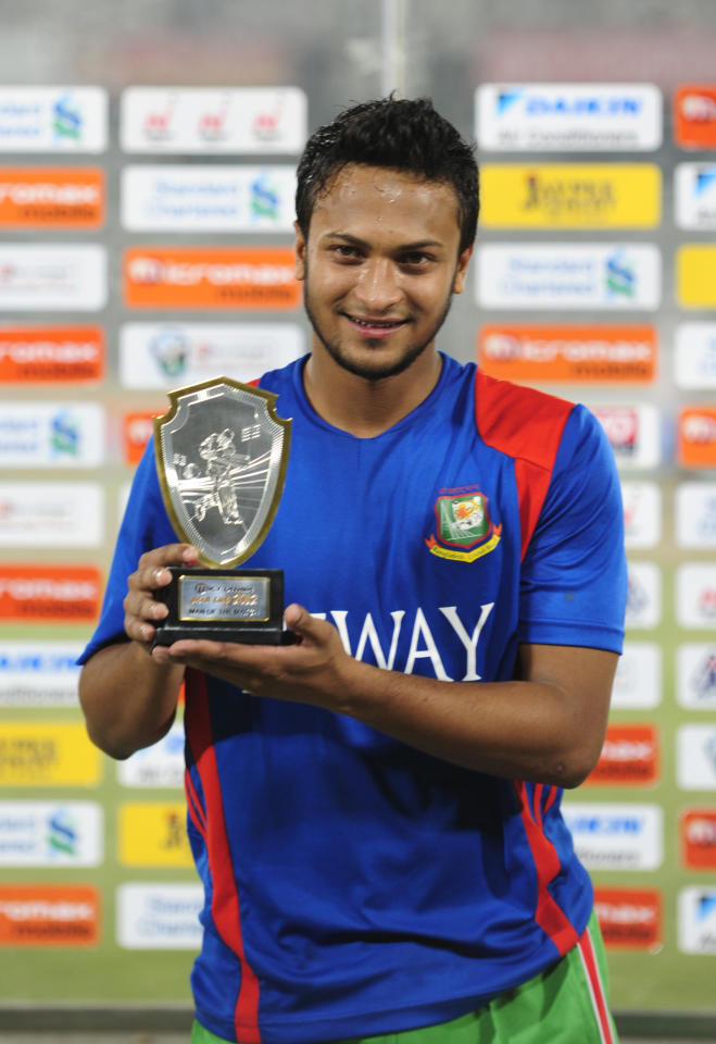 Bangladeshi cricketer Shakib Al Hasan holds the man of the match trophy on March 16, 2012 following the one day international (ODI) Asia Cup cricket match between India and Bangladesh at the Sher-e-Bangla National Cricket Stadium in Dhaka.    AFP PHOTO/ MUNIOR UZ ZAMAN (Photo credit should read MUNIR UZ ZAMAN/AFP/Getty Images)