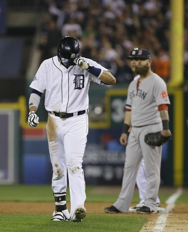 Detroit Tigers' Victor Martinez leaves for a pitch runner after hitting a single in the ninth inning during Game 3 of the American League baseball championship series against the Boston Red Sox Tuesday, Oct. 15, 2013, in Detroit. (AP Photo/Matt Slocum)