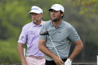 Scottie Scheffler, right, and Ian Poulter, of England, left, watch Scheffler's drive from the No. 6 tee during a round of 16 match at the Dell Technologies Match Play Championship golf tournament Saturday, March 27, 2021, in Austin, Texas. (AP Photo/David J. Phillip)