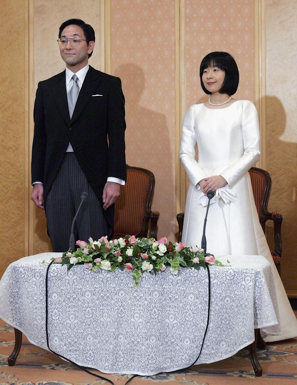 """<p>When she was 36, Princess Nori of Japan left the hereditary monarchy behind when she married a commoner, businessman Yoshiki Kuroda. Per <a href=""""https://www.independent.co.uk/news/world/asia/princess-nori-of-japan-begins-new-life-as-plain-mrs-kuroda-515521.html"""" rel=""""nofollow noopener"""" target=""""_blank"""" data-ylk=""""slk:The Independent"""" class=""""link rapid-noclick-resp""""><em>The Independent</em></a>, """"Emperor Akihito's only daughter took with her a chest of drawers and a table from Tokyo's Imperial Palace, and a £700,000 one-off state payment to help smooth the passage to her new life."""" Meanwhile, <em><a href=""""https://www.telegraph.co.uk/news/worldnews/asia/japan/1476692/Japanese-princess-to-marry-the-best-friend-of-her-brother.html"""" rel=""""nofollow noopener"""" target=""""_blank"""" data-ylk=""""slk:The Telegraph"""" class=""""link rapid-noclick-resp"""">The Telegraph</a></em> reported, """"One possible reason for Princess Sayako's late marriage is that under Japanese law she will lose her royal status on marriage and become a commoner.""""</p>"""