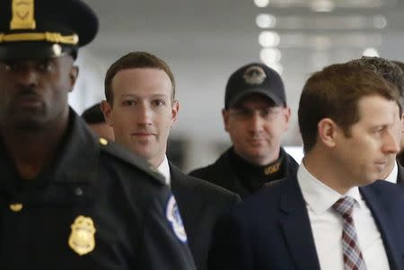 Long lines protest before Facebook CEO Zuckerberg testifiesMore