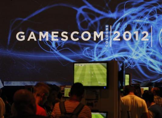 Visitors play computer games during the Gamescom 2012 fair in Cologne August 16, 2012.