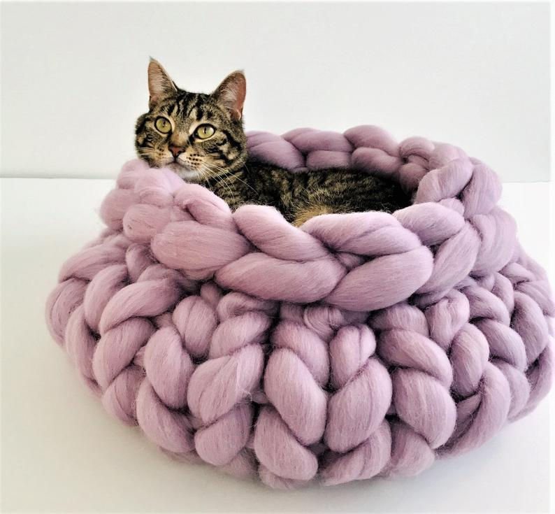 "<br><br><strong>Becozi</strong> Knitted Chunky Cat Bed, $, available at <a href=""https://go.skimresources.com/?id=30283X879131&url=https%3A%2F%2Fwww.etsy.com%2Flisting%2F725681501%2Fcat-bed-knitted-chunky-cat-bed-pet-bed"" rel=""nofollow noopener"" target=""_blank"" data-ylk=""slk:Etsy"" class=""link rapid-noclick-resp"">Etsy</a>"