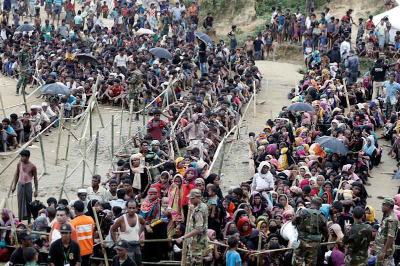 Rohingya refugees queue for aid at Cox's Bazar on Sept. 26.