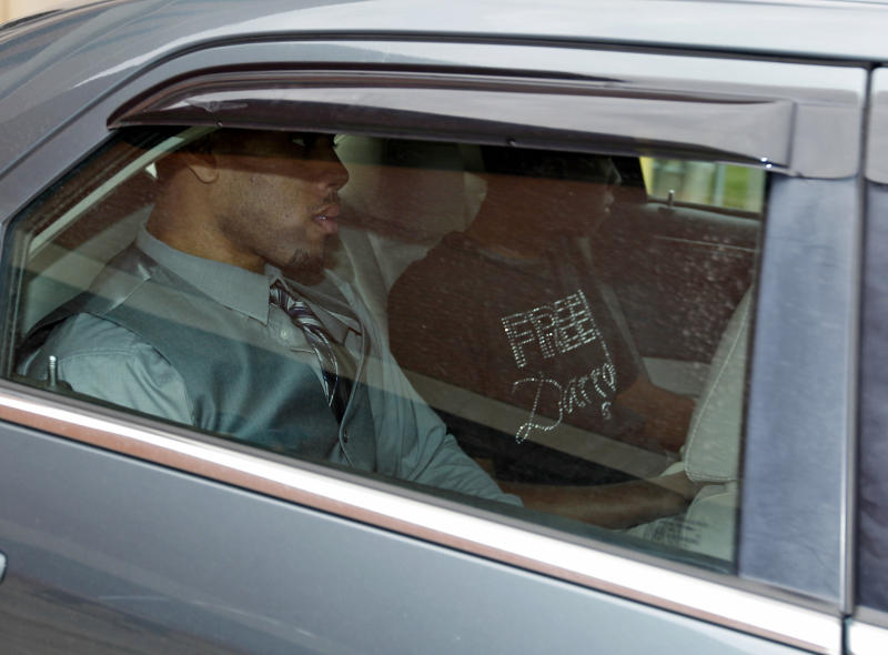 Former Oklahoma State basketball player Darrell Williams, foreground, is driven away from the Payne County Jail in Stillwater, Okla., Friday, Oct. 12, 2012, after he avoided more time behind bars when a judge gave him a suspended sentence in a sexual assault case in which Williams insisted he was innocent. His brother, Pierre, is at right. (AP Photo/Sue Ogrocki)