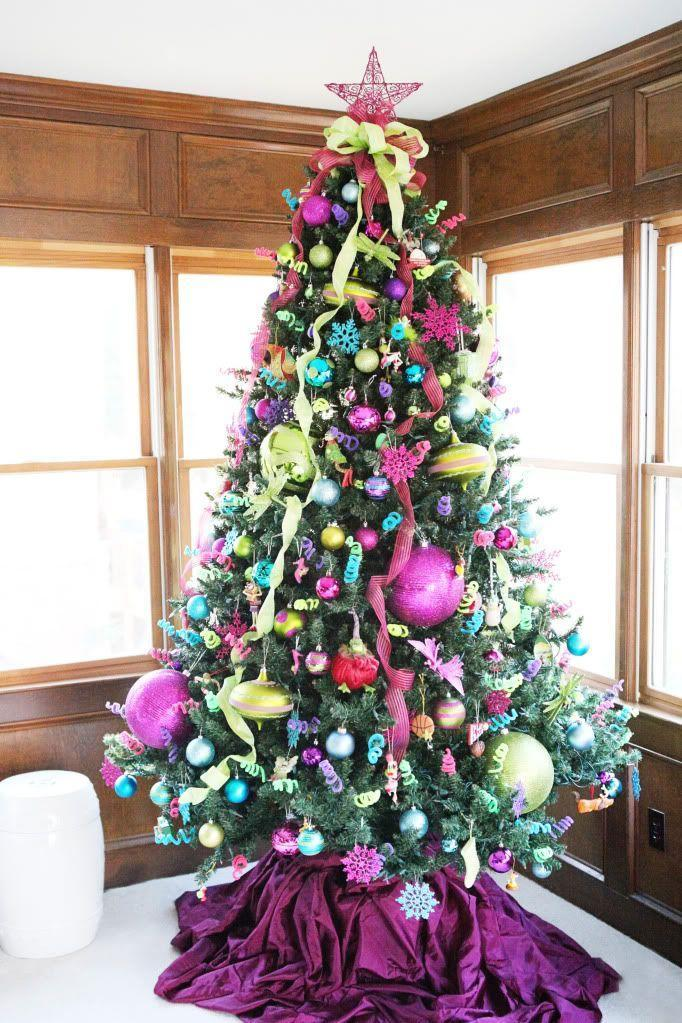 "<p>Incorporate bold hues like pink, lime, turquoise, and purple for a seriously show-stopping tree.</p><p>See more at <a href=""http://www.bowerpowerblog.com/2011/12/ho-ho-home/"" rel=""nofollow noopener"" target=""_blank"" data-ylk=""slk:Bower Power"" class=""link rapid-noclick-resp"">Bower Power</a>.</p><p><a class=""link rapid-noclick-resp"" href=""https://www.amazon.com/ShinyBeauty-Purple-Christmas-Tree-Skirt-Christmas/dp/B01N7AS5NY/?tag=syn-yahoo-20&ascsubtag=%5Bartid%7C10057.g.505%5Bsrc%7Cyahoo-us"" rel=""nofollow noopener"" target=""_blank"" data-ylk=""slk:SHOP TREE SKIRTS"">SHOP TREE SKIRTS</a><em> <strong>Purple Tree Skirt, $14</strong></em></p>"