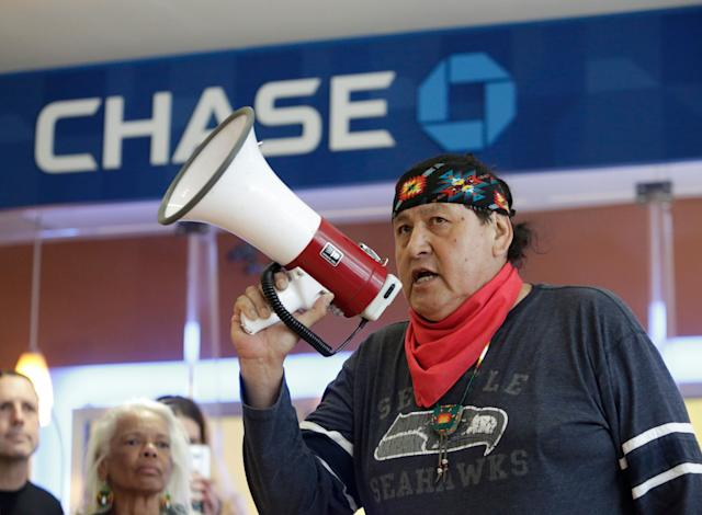 Raymond Kingfisher speaks as indigenous leaders and climate activists disrupt business on May 8 at a Chase Bank branch in Seattle to protest funding tar sands development and projects like the Keystone XL pipeline.