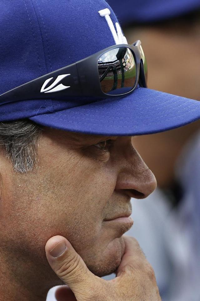 Los Angeles Dodgers manager Don Mattinglyn watches from the dugout during the seventh inning of Game 2 of the National League baseball championship series against the St. Louis Cardinals Saturday, Oct. 12, 2013, in St. Louis. (AP Photo/David J. Phillip)