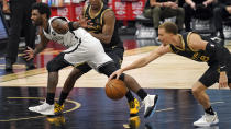 Toronto Raptors guard Malachi Flynn (8) steals the ball from Brooklyn Nets guard Kyrie Irving (11) during the second half of an NBA basketball game Tuesday, April 27, 2021, in Tampa, Fla. (AP Photo/Chris O'Meara)