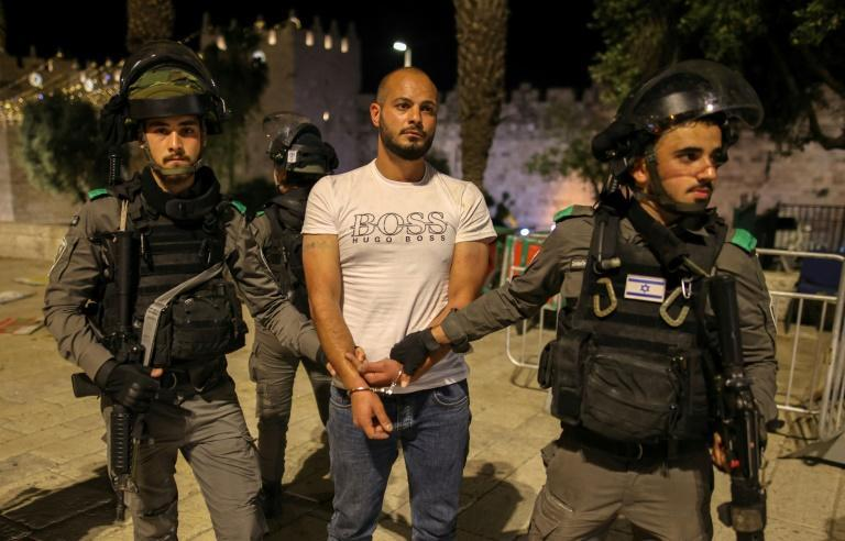 Israeli security forces detain a protester during clashes with Palestinian protesters outside Damascus Gate