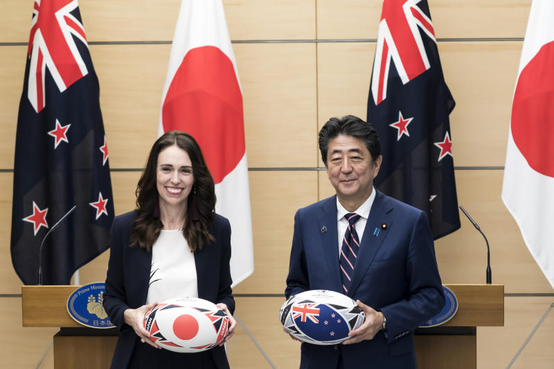 New Zealand's Prime Minister Jacinda Ardern, left, and Japan's Prime Minister Shinzo Abe hold rugby balls after a joint press conference following a meeting at Abe's official residence in Tokyo Thursday, Sept. 19, 2019. (Tomohiro Ohsumi/Pool Photo via AP)