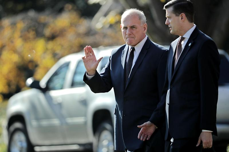 White House Chief of Staff John Kelly (L) waves to journalists as he and Staff Secretary Rob Porter leave the White House: Getty/Chip Somodevilla