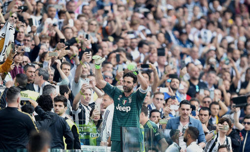 Juventus goalie Gianluigi Buffon greets supporters at the Allianz Stadium in Turin, Italy, Saturday, May 19, 2018. Juventus beat already relegated Hellas Verona 2-1 in the final round of the season on Saturday but the result mattered little as the club bid an emotional farewell to Buffon, while it also received a record-extending seventh successive Serie A trophy. (Alessandro Di Marco/ANSA via AP)