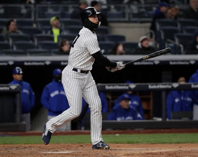 New York Yankees' Giancarlo Stanton connects for a two-run home run against the Toronto Blue Jays during the third inning on Friday, April 20, 2018, in New York. (AP Photo)