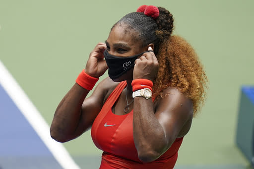 Serena Williams, of the United States, puts on a mask after defeating Tsvetana Pironkova, of Bulgaria, during the quarterfinals of the US Open tennis championships, Wednesday, Sept. 9, 2020, in New York. (AP Photo/Seth Wenig)