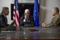 FILE - In this Nov. 23, 2019, file photo Vice President Mike Pence, accompanied by U.S. Ambassador to Iraq Matthew Tueller, left, and Lt. Gen. Pat White, right, takes a phone call with Iraqi Prime Minister Adil Abdul-Mahdi at Al Asad Air Base, Iraq. White is the Fort Hood commander and he is facing the grim task of rebuilding trust and turning around an installation that has one of the highest rates of murder, sexual assault and harassment in the Army. (AP Photo/Andrew Harnik, File)