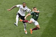 <p>Mexico's forward Javier Hernandez (R) vies for the ball with Germany's defender Jerome Boateng during the Russia 2018 World Cup Group F football match between Germany and Mexico at the Luzhniki Stadium in Moscow on June 17, 2018. (Photo by Mladen ANTONOV / AFP) </p>