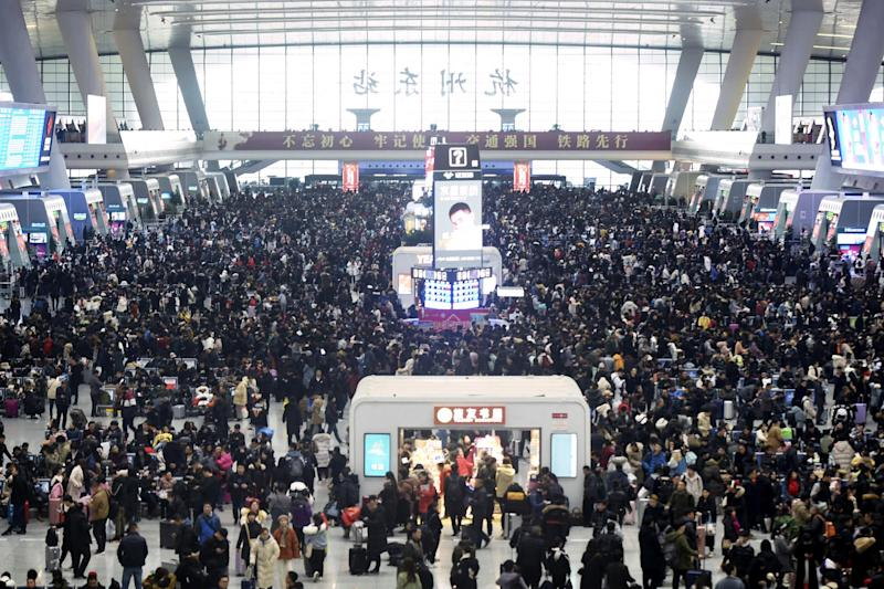Passengers wait for their trains at the Hangzhou East Railway Station: AP