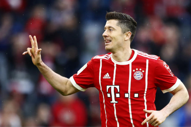 Bayern's Robert Lewandowski celebrates after scoring his side's sixth goal during the German Soccer Bundesliga match between FC Bayern Munich and Hamburger SV in Munich, Germany, Saturday, March 10, 2018. (AP Photo/Matthias Schrader)