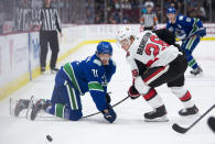 Vancouver Canucks left wing Loui Eriksson (21) tries to get the puck past Ottawa Senators defenseman Erik Brannstrom (26) during the second period of an NHL hockey game Tuesday, Dec. 3, 2019, in Vancouver, British Columbia. (Jonathan Hayward/The Canadian Press via AP)