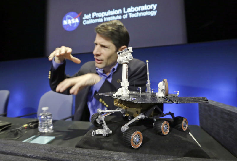 John Callas, Mars Exploration Rovers project manager, with a one-tenth Rover scale model, speaks at a news conference marking the 10th anniversary of the NASA Mars Opportunity rover mission, at a news conference at Jet Propulsion Laboratory in Pasadena, Calif., Thursday, Jan. 23, 2014. (AP Photo/Reed Saxon)