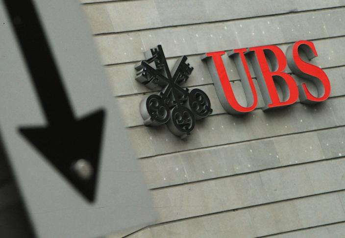FILE -In this Jan. 24, 2013 file photo the logo of Swiss bank UBS is pictured in Zurich, Switzerland. The European Commission has fined a group of major global banks a total of 1.7 billion euros (US dollar 2.3 billion) for colluding to profit from the interest rates market as it was announced Wednesday, Dec. 4, 2013. The banks, which includes UBS bank are accused of manipulating for years European and Japanese benchmark interest rates that affect hundreds of billions of dollars in contracts globally, from mortgages to credit card bills. (AP Photo/Keystone, Steffen Schmidt, File)