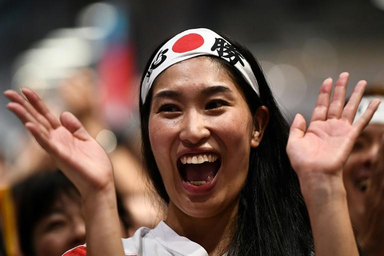 Japanese fans celebrated late into the night (AFP Photo/Anne-Christine POUJOULAT)